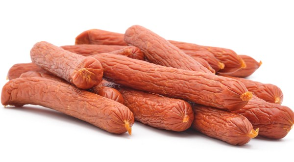 A pile of sticks of dried pepperoni