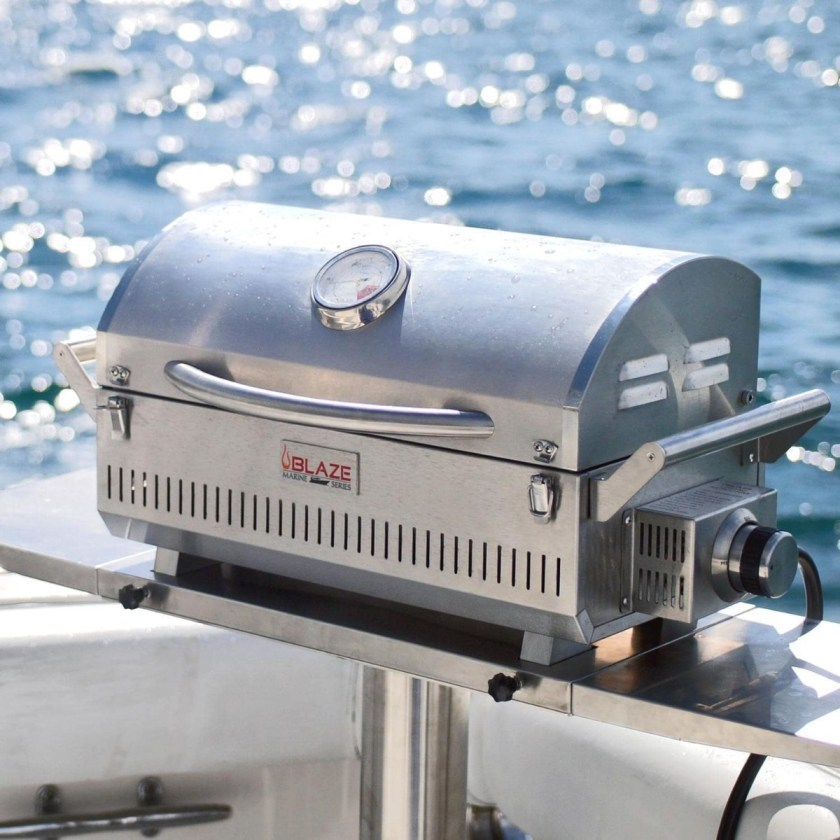 A Blaze Professional Marine Grade Portable Gas Grill with its lid closed on a boat and utilizes stainless steel that is 316L.