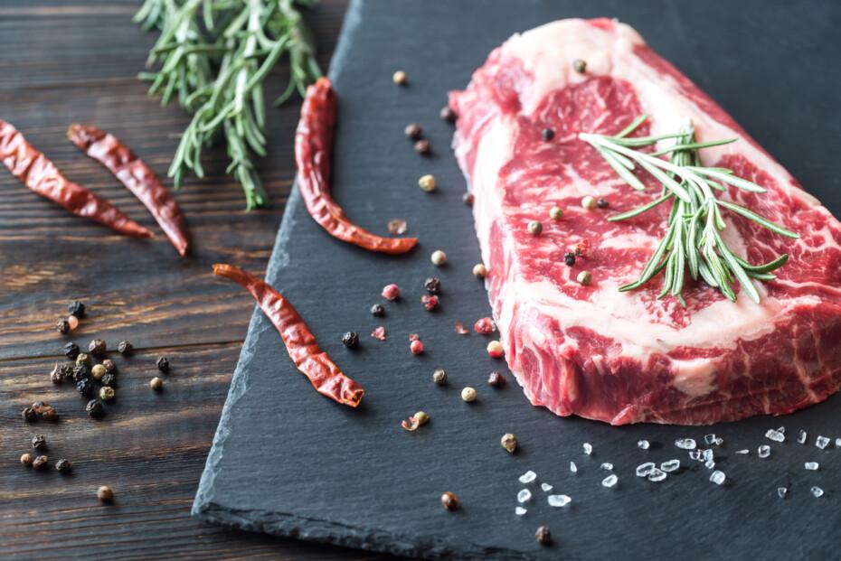 Raw Beef Steak With Fresh Rosemary