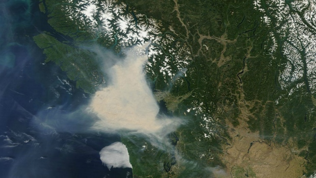 In this image from NASA, smoke is seen over Vancouver Island and southern British Columbia on Sunday, July 5, 2015. (NASA)