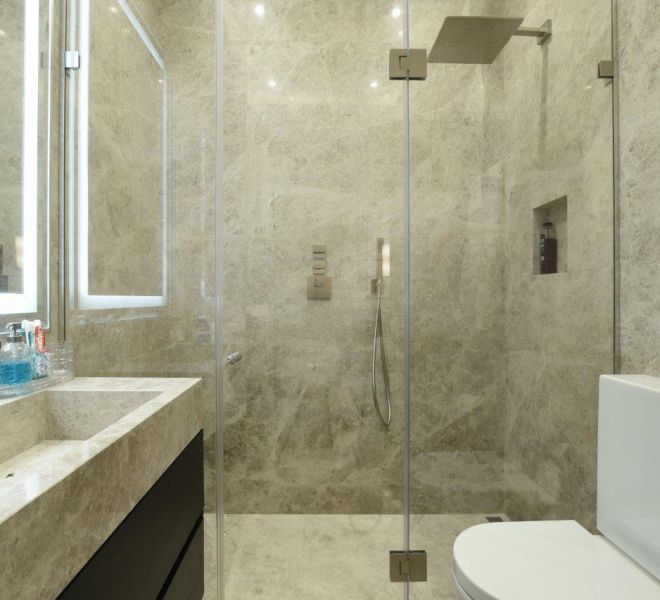 Marble clad bathroom suite by Brompton Cross construction