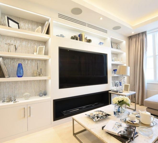 Living room custom bespoke fitted media unit by Brompton Cross Construction