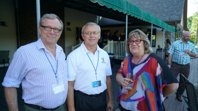 John Sucese (middle) with customers enjoying Brook-Lea Country Club's outdoor patio.