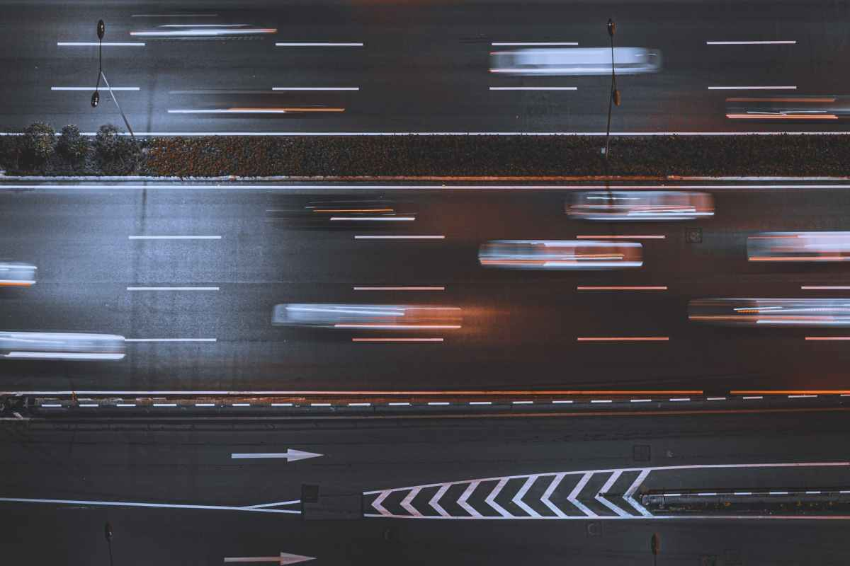 time lapse photo of cars in asphalt road