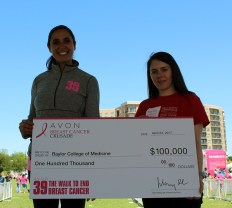 Dr. Stacey Carter, right, accepts a grant check from the Avon Foundation.