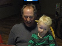 Sitting in my dad's lap video chatting with my sisters in TN and CA