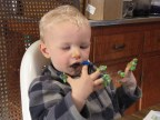 Licking the icing from his fingers on his birthday