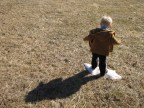 My son stomping the last patch of snow while his shadow watched