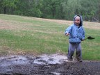 My son insisted on playing in the rain on a cold May day