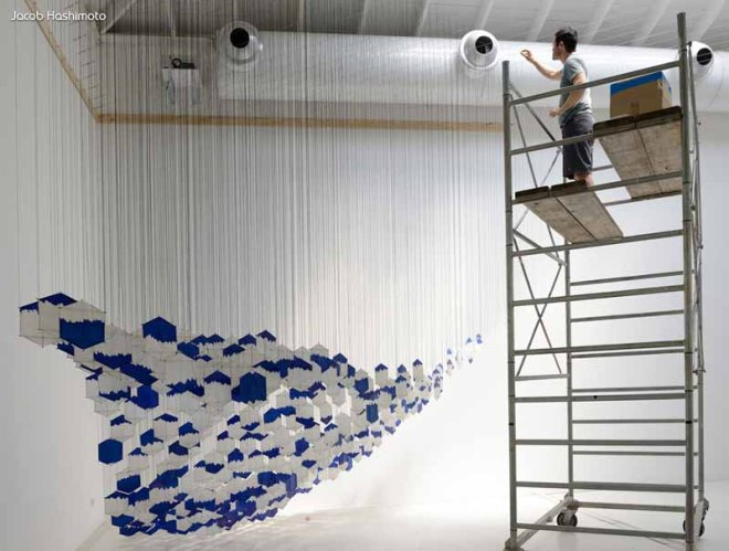 Jacob Hashimoto working on one of his 3D Kite Installations