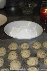 Roll the cooled cookies in the confectioners sugar to coat.