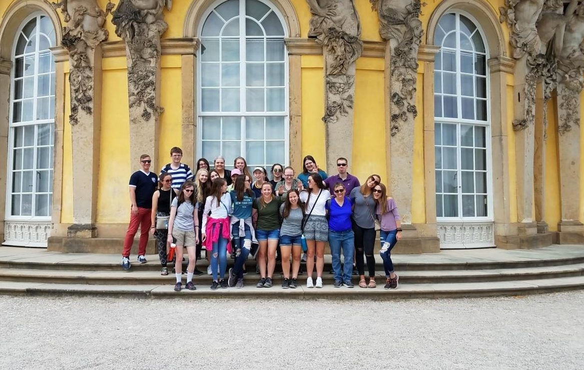 Mr. Macdonald stands with the BDHS tour group outside the Sanssouci Palace in Potsdam, Germany.