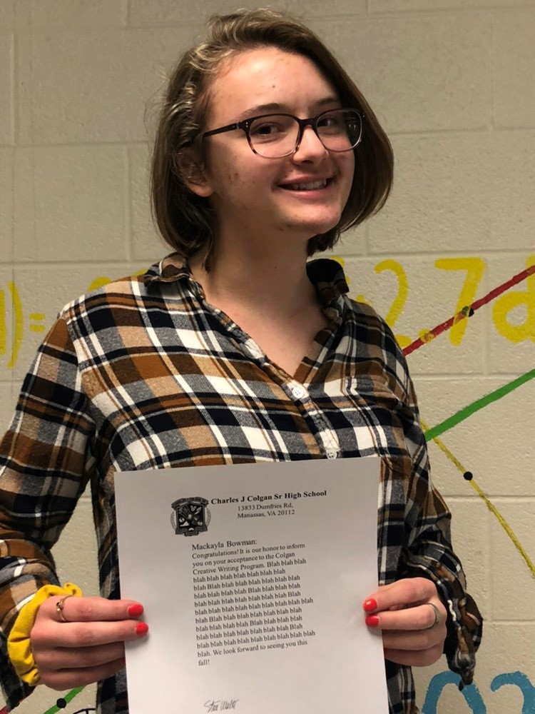 Makayla Bowman holds her acceptance letter to Colgan's Fiction Creative Writing Program
