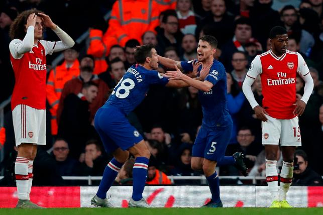 Chelsea`s Italian midfielder Jorginho (2R) celebrates scoring their first goal to equalise 1-1 with Chelsea`s Spanish defender Cesar Azpilicueta (2L) as Arsenal`s French midfielder Matteo Guendouzi (L) and Arsenal`s English midfielder Ainsley Maitland-Niles (R) react during the English Premier League football match between Arsenal and Chelsea at the Emirates Stadium in London on Sunday. Photo: AFP