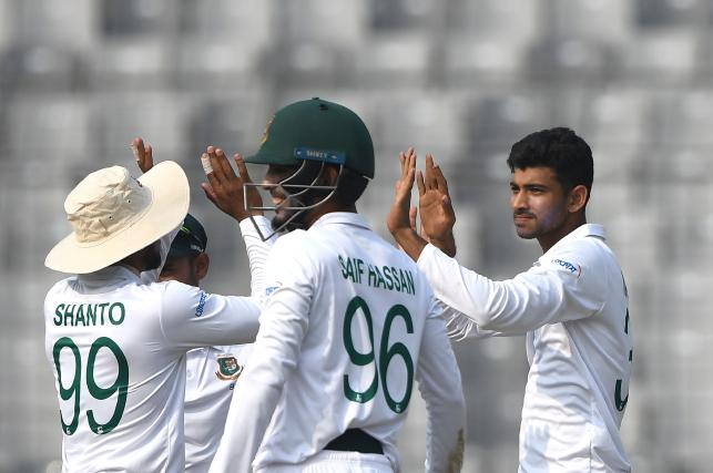 Bangladesh`s Nayeem Hasan (R) celebrates with teammates after the dismissal of the Zimbabwe`s Sikandar Raza (unseen) during the first day of the first Test cricket match between Bangladesh and Zimbabwe at the Sher-e-Bangla National Cricket Stadium in Dhaka on 22 February, 2020. Photo: AFP