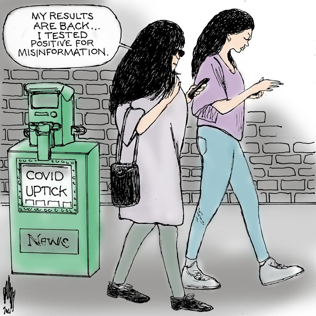 Two women walk past a newspaper box bearing the headline,