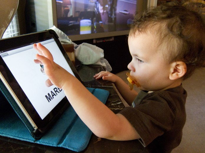 child-playing-ipad