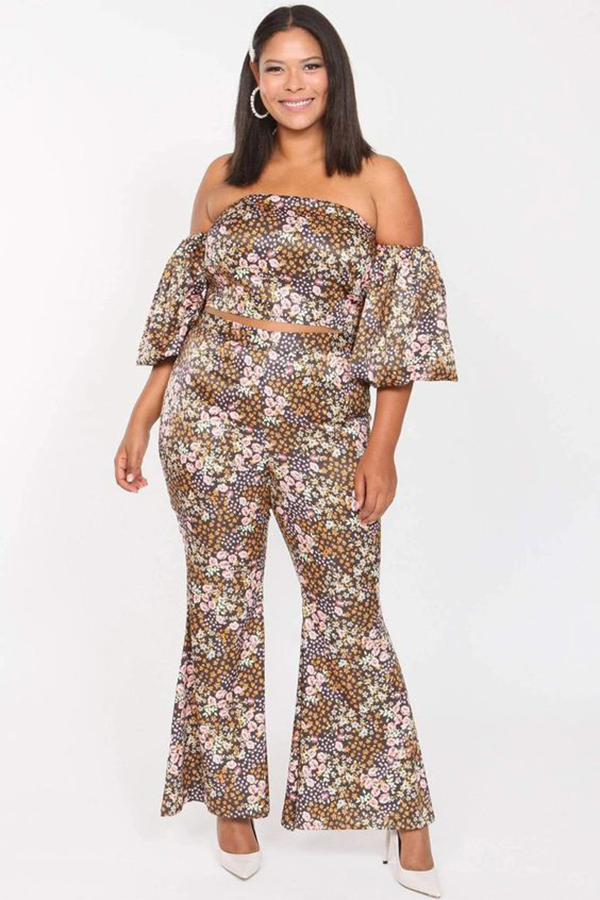 A plus-size model wearing a floral matching set.