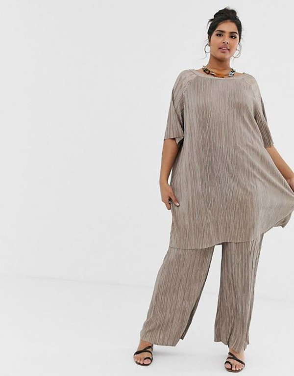 A plus-size model wearing a taupe matching set.