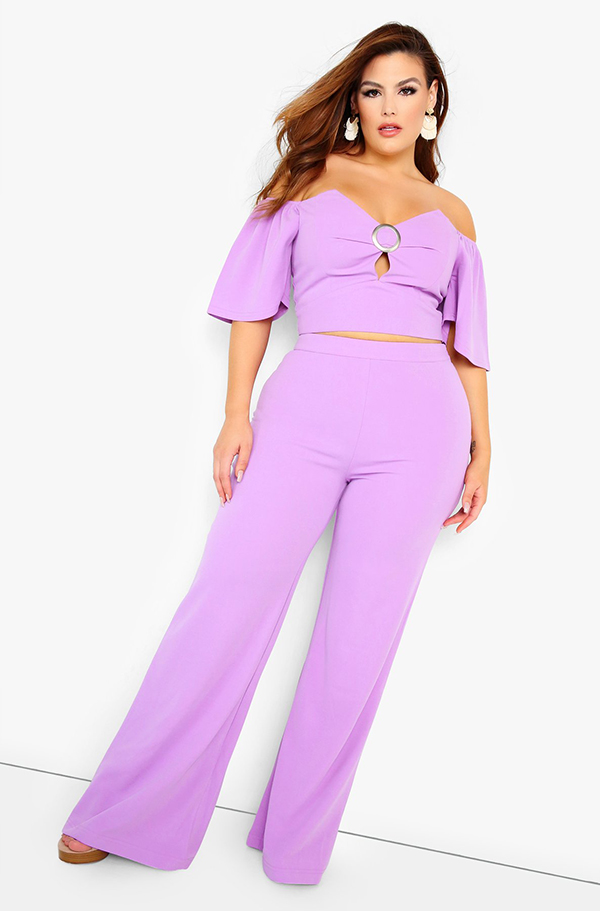 A plus-size model wearing a lavender matching set.