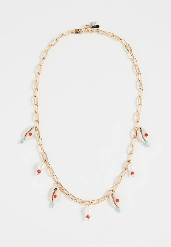 A gold chain necklace punctuated by painted cowrie shells.