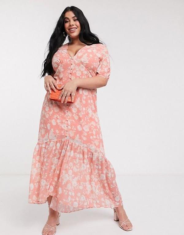 A plus-size model wearing a floral maxi dress.