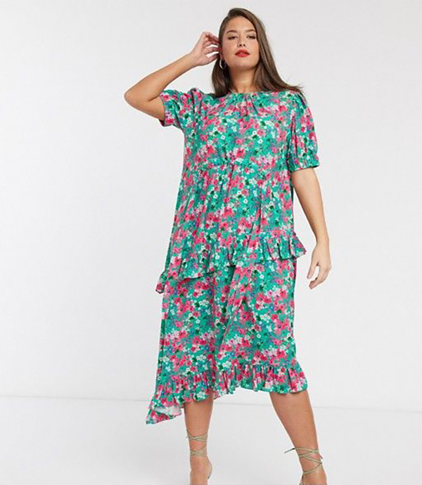 A plus-size model wearing a floral dress.