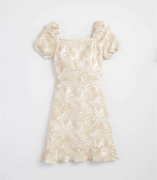 A plus-size taupe tropical print dress.