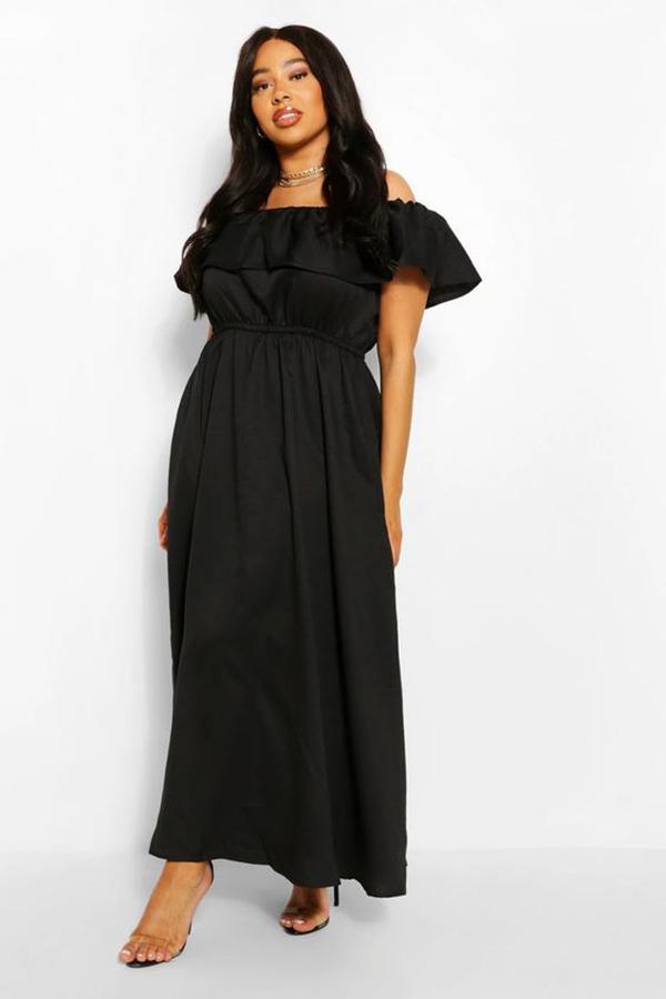 A plus-size model wearing a black off-the-shoulder maxi dress.