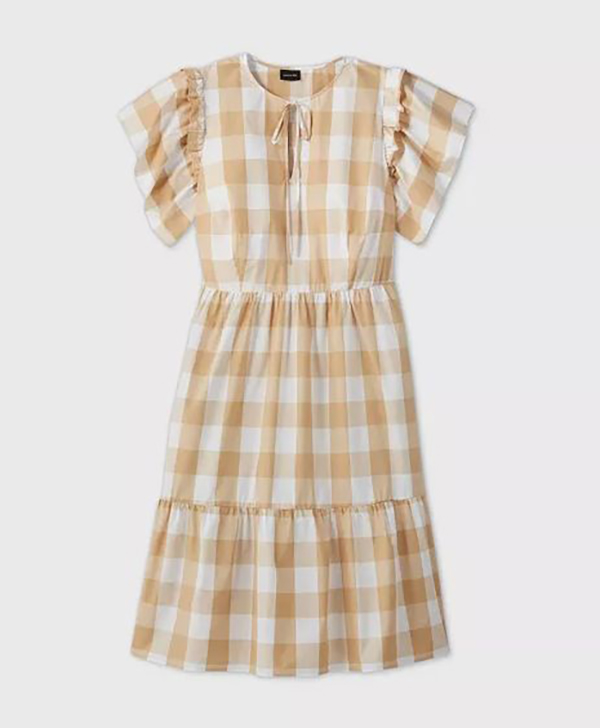 A plus-size taupe gingham sundress.