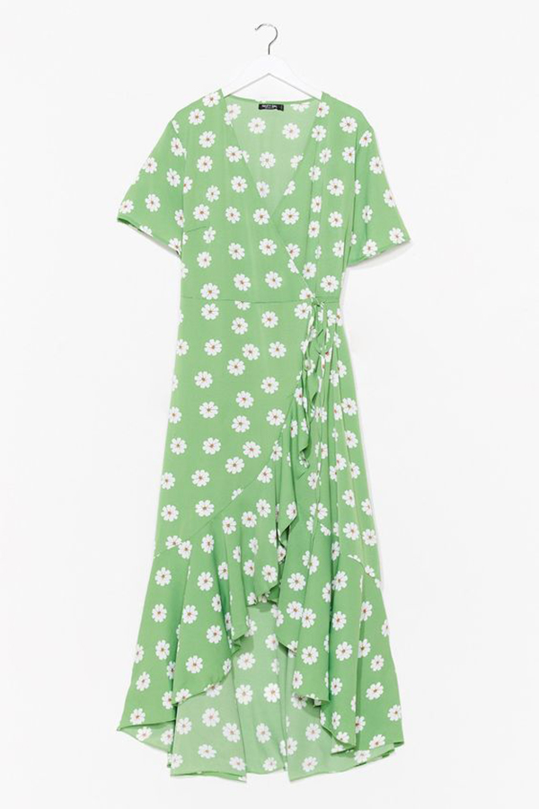 A plus-size green floral midaxi dress.