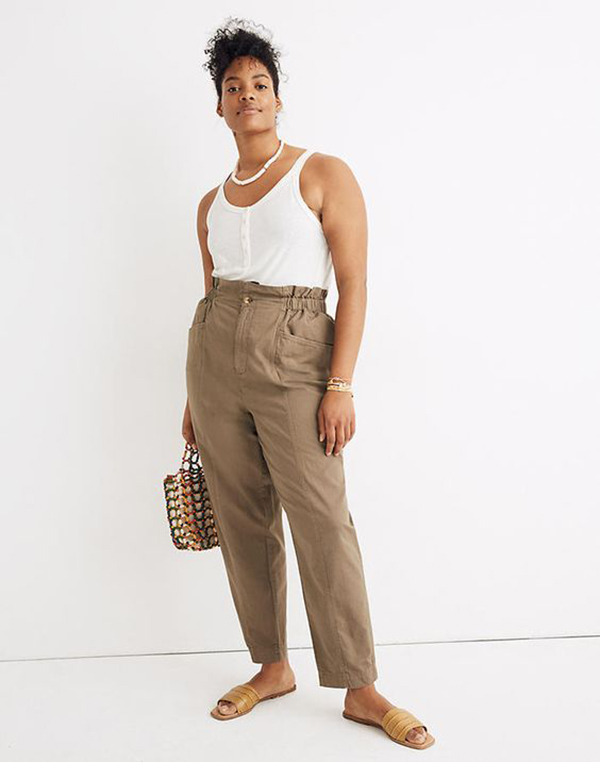 A plus-size taupe model wearing cargo pants.