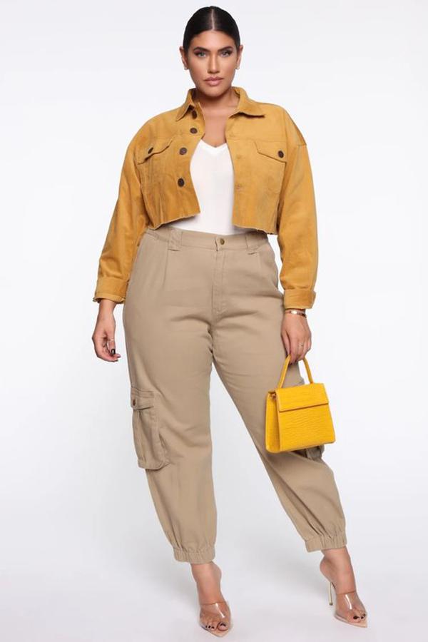 A plus-size model wearing beige cargo pants.