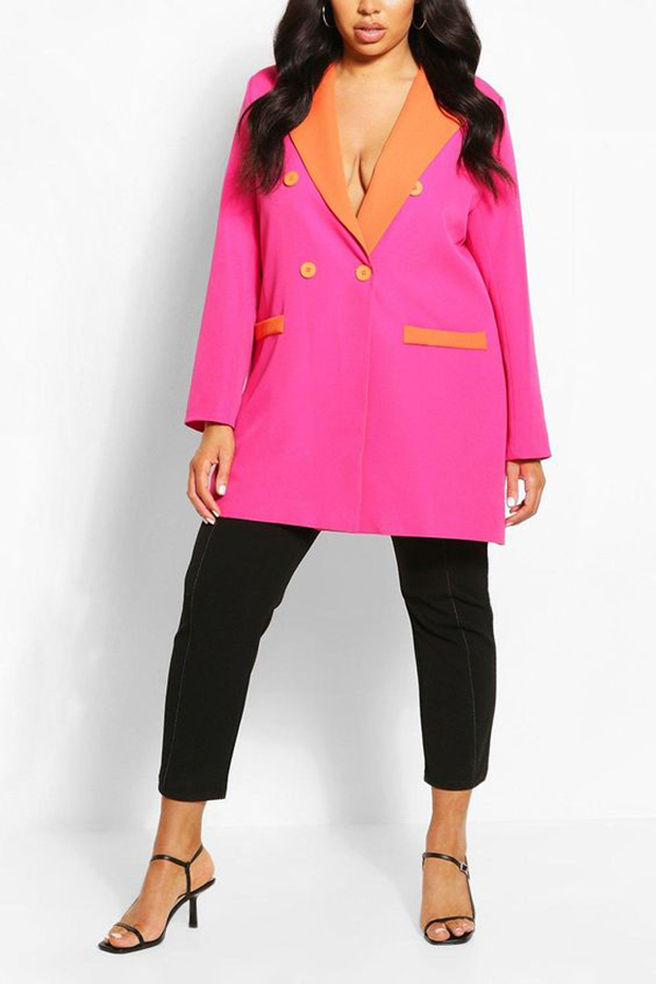 A plus-size model wearing a neon pink and orange blazer.