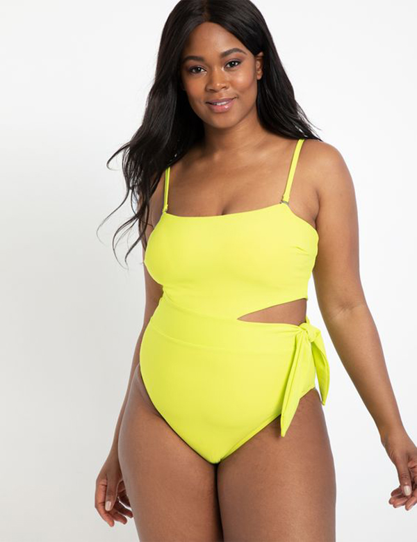 A plus-size model wearing a neon yellow swimsuit.