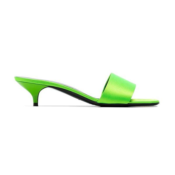 A neon green slip-on kitten heel.