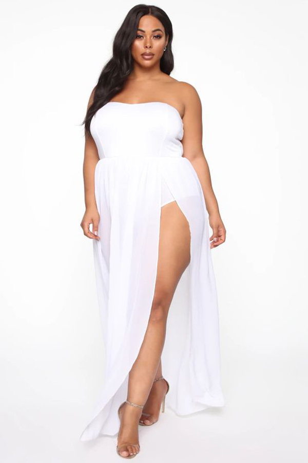A plus-size model wearing a white maxi dress.