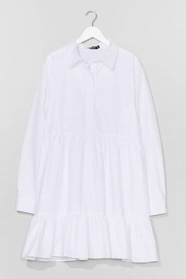 A plus-size white shirtdress.