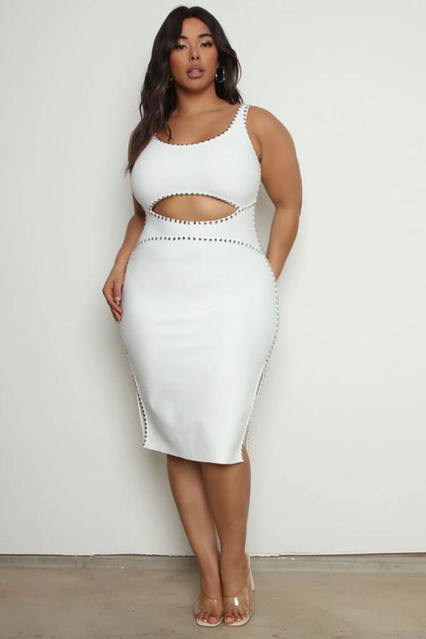 A plus-size model wearing a white dress.