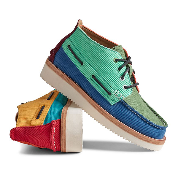 A pair of multicolor corduroy shoes.