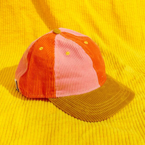 A pink and orange corduroy baseball cap.