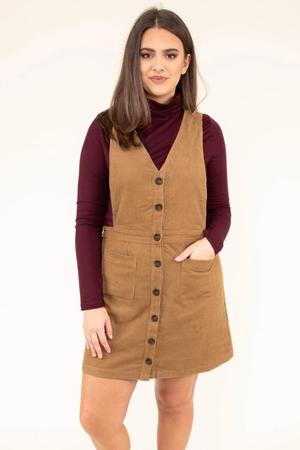 A plus-size model wearing a corduroy jumper.