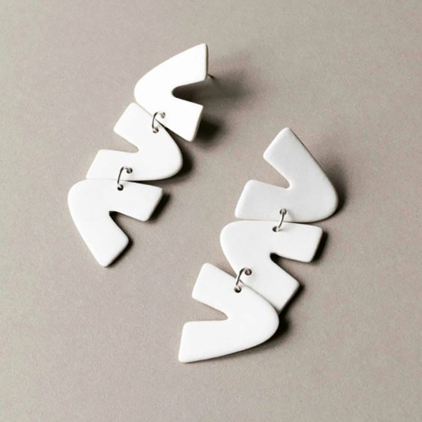 White drop earrings that look like squiggles