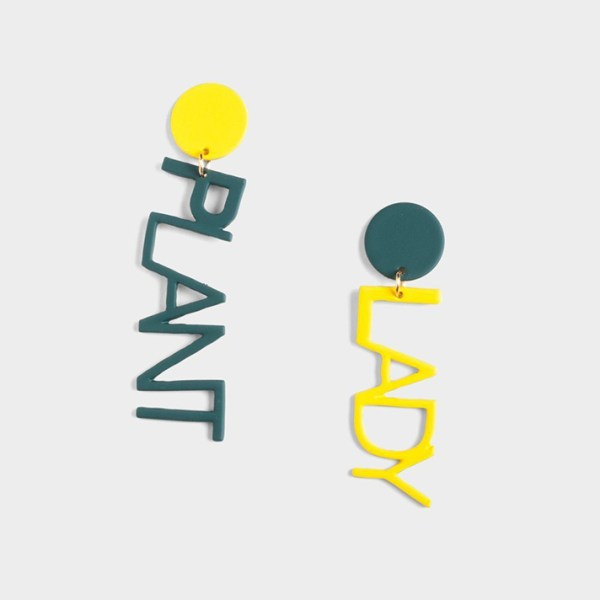 "Green and yellow drop earrings that say ""PLANT"" and ""LADY"""