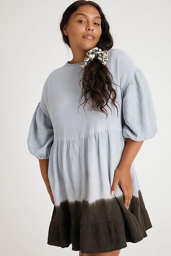 A plus-size model wearing a tie-dye dress.