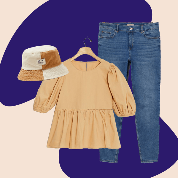 brown and white patchwork bucket hat, tan babydoll blouse, and mid-wash jeans