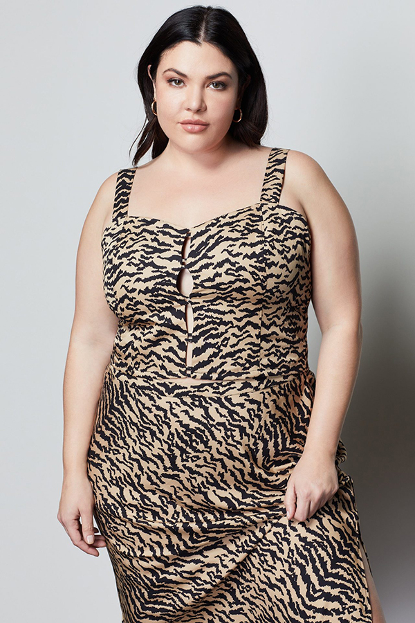 A plus-size model wearing an animal print bustier crop top.