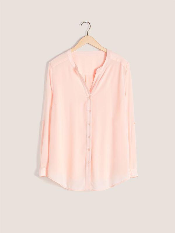 A light pink button down blouse.