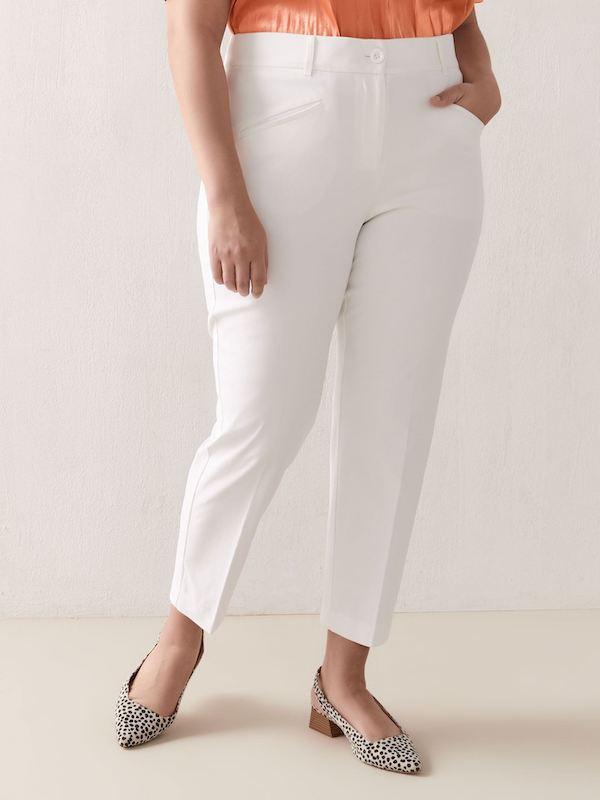 A woman wearing white pants.