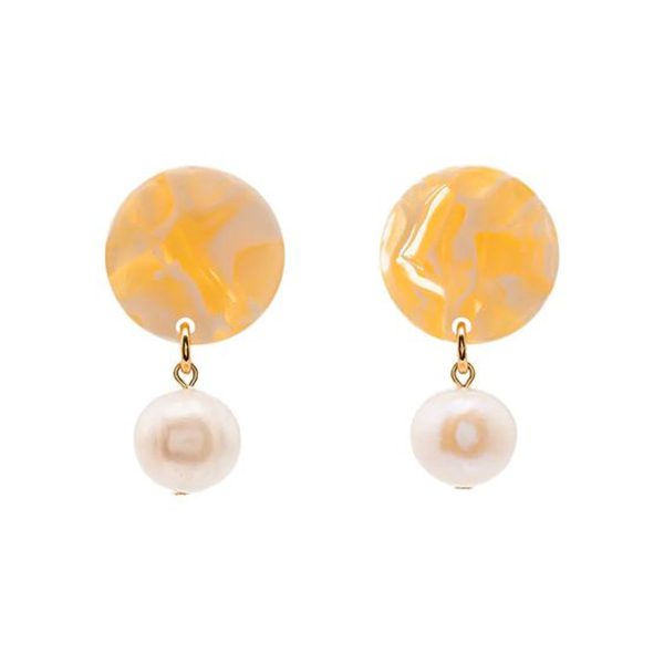 Orange drop earrings with pearls.